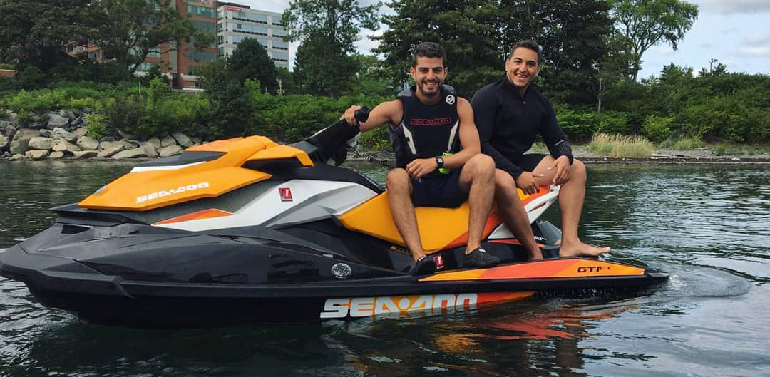 Ossama Nasralla and Omar Hassan on a watercraft.