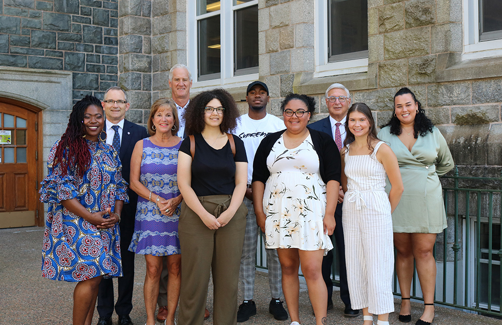 The Diversity Excellence Award recipients with donors Scott McCain and Leslie McLean, Charimsa Grace Walker, Dr. Robert Summerby-Murray, and Board Chair Larry Freeman